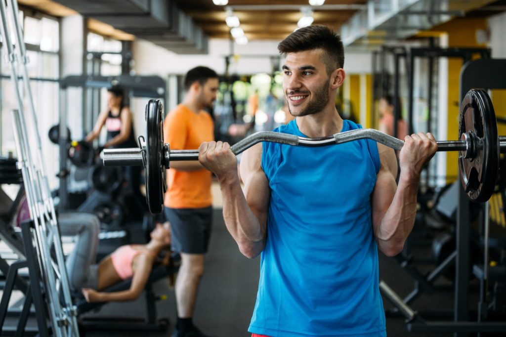 Determined male working out in gym