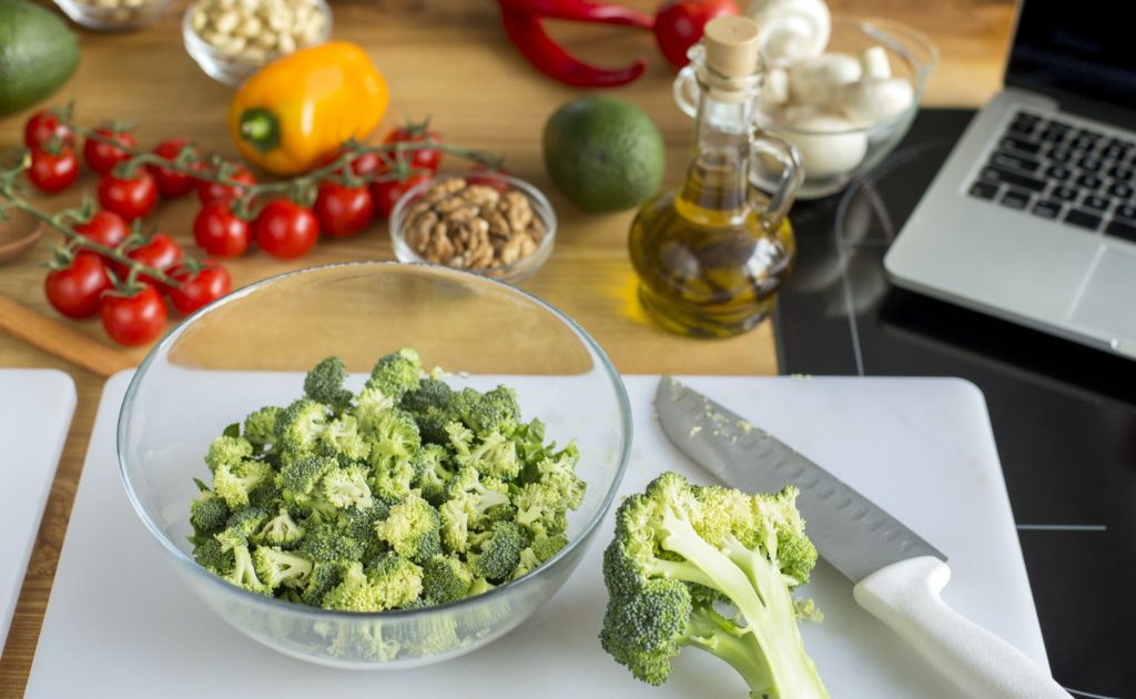 Healthy kitchen flat lay of fresh broccoli and other vegetables